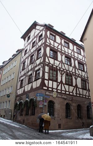 Nuremberg Germany - December 30 2014: view of the Durer House in winter time on December 30 2014 in Nuremberg Germany.