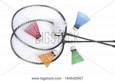 Two Badminton racquets with five color shuttlecocks isolated on white