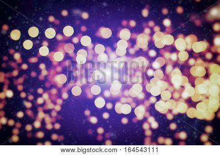 Festive background with natural bokeh and bright purple lights. Vintage Magic background with colorful bokeh. Spring Summer Christmas New Year disco party background.