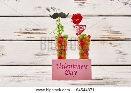 Valentine's Day card and props. Colorful streamer and candy pebbels. Mix of color and taste.