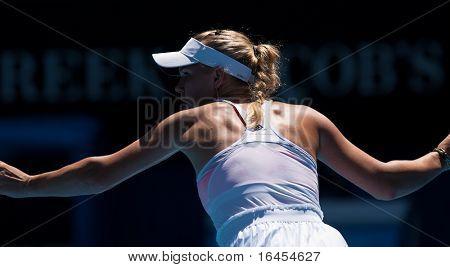 MELBOURNE - JANUARY 27: Caroline  Wozniacki of Denmark in her semi final loss to Li Na of China in the 2011 Australian Open on January 27, 2011 in Melbourne, Australia