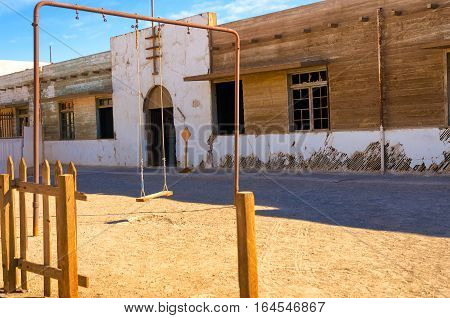 Swingset outside an abandoned school in Humberstone Chile