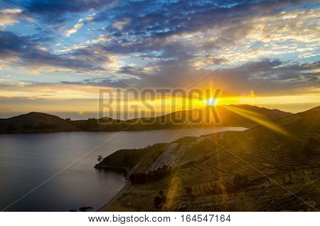 View of a stunning sunset over Lake Titicaca from the Island of the Sun in Bolivia