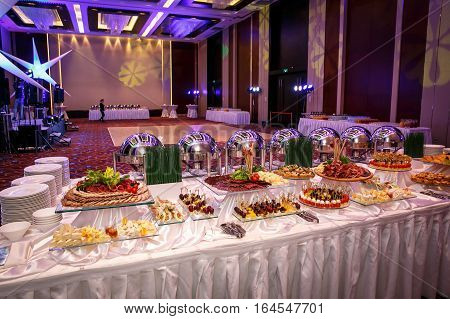 Catering service. Restaurant table with food at event. Plate with snacks