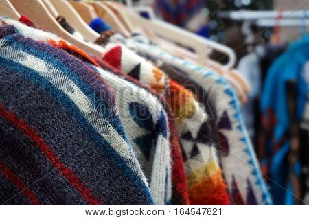 Traditional Multi Colored Woolen Knitwear Clothes For Sale On A Market Stall Traditional Multi Color