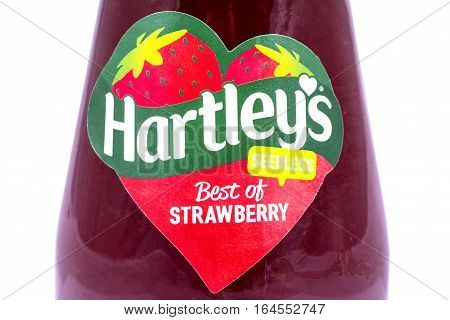 LONDON UK - JANUARY 4TH 2017: A close-up of the label on a jar of Hartleys seedless Strawberry Jam over a plain white background on 4th January 2017. The Hartleys brand is owned by Hain Daniels Group.