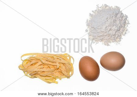 traditional tagliatelle pasta with eggs and flour on white background