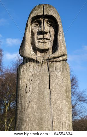 WALTHAM ABBEY UK - JANUARY 2ND 2017: An oak sculpture by Helena Stylianides entitled Ancestor located in the grounds of Waltham Abbey Church in Waltham Abbey Essex on 2nd January 2017.