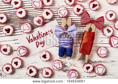 Clothespins and Valentine's Day card. Bow ties and candies. Start day with sweet surprise.