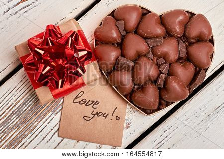 Love you card and chocolates. Gift box, greeting paper, candies. Delicious magic moments.