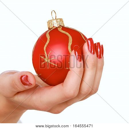 Christmas decoration in hand, isolated on white background.