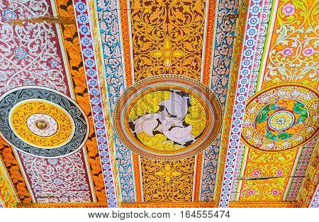 ANURADHAPURA SRI LANKA - NOVEMBER 26 2016: The wooden ceiling in Isurumuniya Rock Temple covered with colorful painted Buddhist patterns including floral and animalistic themes on November 11 in Anuradhapura.