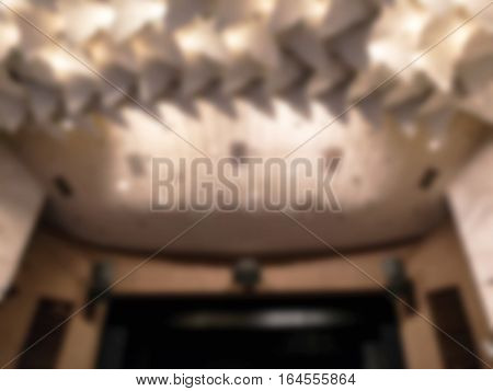 Blured. Decorative Light Lamps Hanging On The Ceiling Of Dark Room As Abstract Background. As A Blur