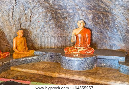 ANURADHAPURA SRI LANKA - NOVEMBER 26 2016: The Buddhist figures in Isurumuniya Rock Temple symbolising protection of fear on November 11 in Anuradhapura.