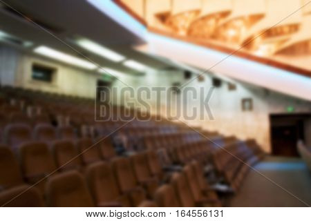 Blured. Modern Theater With Soft Lighting And Interior View. As A Blurred Background For Any Adverti
