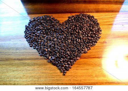 Coffee Bean Heart Against Wood Grain