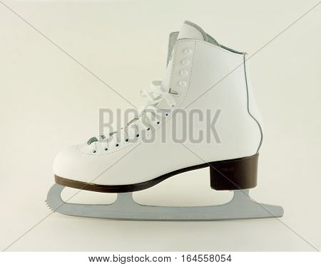 One Ice-skate white shoe with blade isolated side view closeup