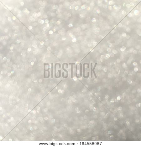 silver glitter bokeh from fresh snow abstract texture background