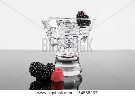Sparkling Beverage In A Martini Glass With A Blackberries And Raspberries