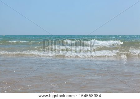 Sea blue bottom summer wave background. Vacation relax on the beach. The beautiful sandy beach of the Mediterranean Sea.