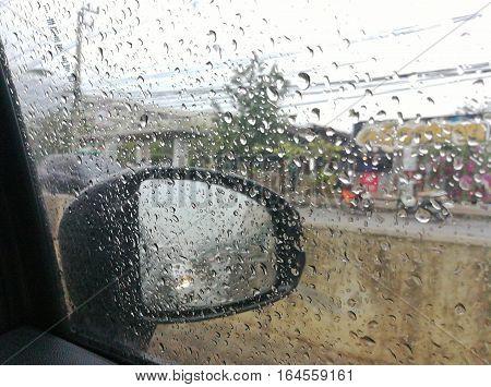 Rain drop on the car window grass.