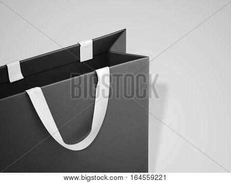Black shopping bag with white handles on white floor. 3d rendering