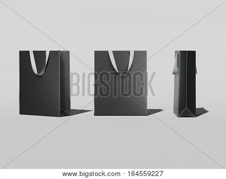 Three black shopping bags in bright studio. 3d rendering