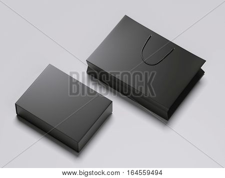 Black blank box and shopping bag on a gray floor. 3d rendering