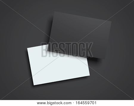 Black and white business cards on a dark floor. 3d rendering