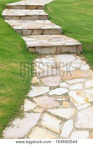 Garden block stone walkway and green gress