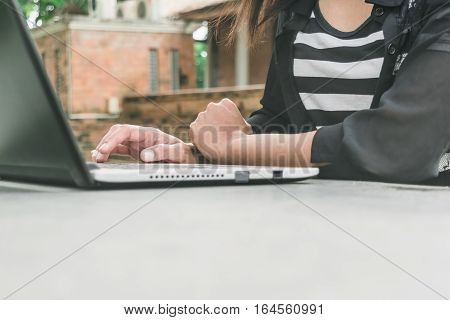 Selective focus  woman hand working project analysis plans with generic design laptop. Smart work process concept.