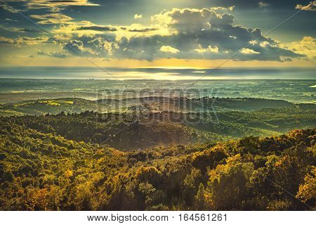 Maremma sunset panorama. Countryside hills and sea on horizon. Val di Cecina Livorno coast Tuscany Italy Europe