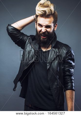 young attractive bearded hipster man gesturing emotional screaming in studio sucsess close up