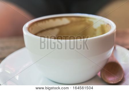 Close Up Empty White Cup Of Coffee On The Wooden Table.