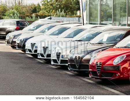 PARIS FRANCE - OCT 10 2015: Brand new Alfa-Romeo italian cars in a row waiting for their customers - modern beautiful car dealership for sale.
