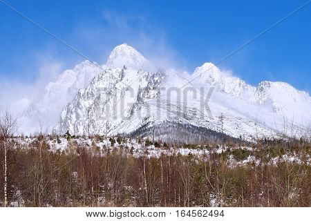 View of the High Tatras mountains with the peaks covered with snow from Horny Smokovec. Slovakia.