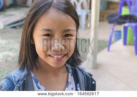 Close Up Happy Adorable Asian Kids. Portrait Of Happy Joyful Smiling Kids With Sunshine.