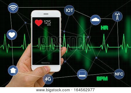 Concept of smart watch monitoring heart rate application with heart beat cardiogram while exercising.