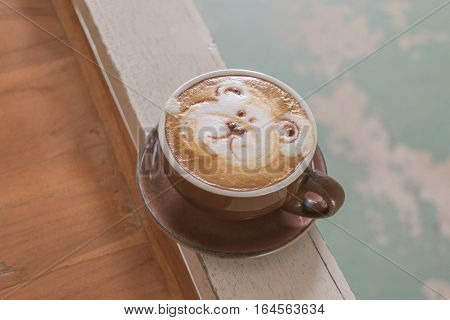 Close Up White Cup Of Coffee With Bear Hand Drawn On Top, Coffee Latte On The Wooden.