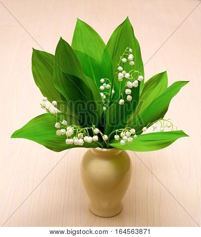 Bouquet of lily of the valley in vase on the table