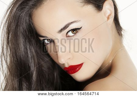 beautiful woman face with red lips studio closeup portrait