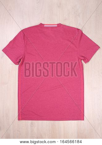 Back view sport tshirt on wooden background