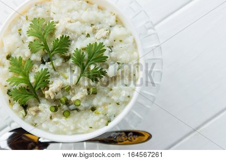 porridge, rice soup white wooden table with blank space