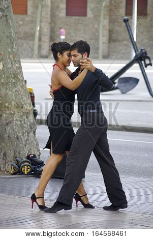Tango Dancers Along The Streets In Barcelona.