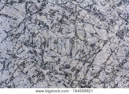 Close up black marble stone wall patterned use for texture background
