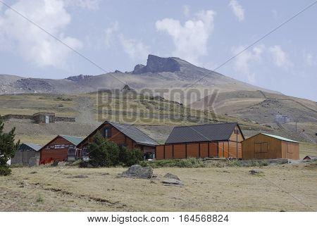 Wooden Huts In Sierra Nevada, The Highest Peaks Of Inland Spain.