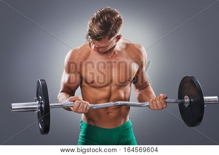 Handsome Muscular Man Doing Biceps Curls With Barbell. Concept Of Healthy Lifestyle