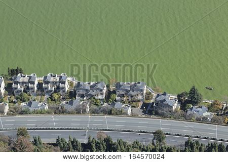 Houses and very polluted lake in China