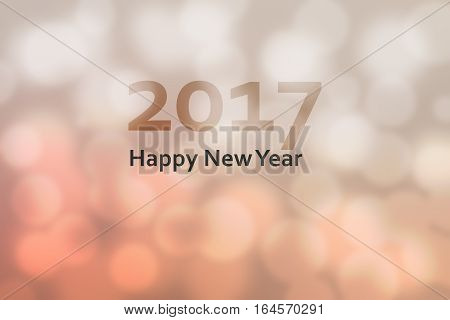 Happy new year 2017. Abstract background with motion blur and bokeh. retro vintage and warm color tone.