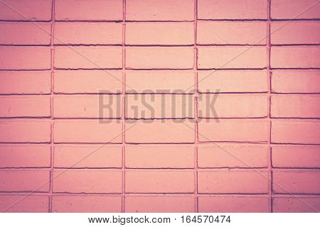Background of orange brick wall. Retro vintage filter effect.